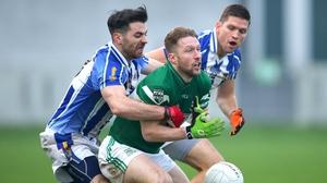 Ballyboden St Enda's Michael Darragh Macauley and Conal Keaney tackle Cahir Healy of Poraloise
