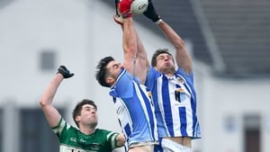 Michael Darragh Macauley and Declan O'Mahony rise for a high ball