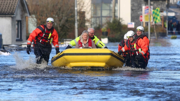 A woman is evacuated in Craughwell, Co Galway (Pic: Hany Marzouk)