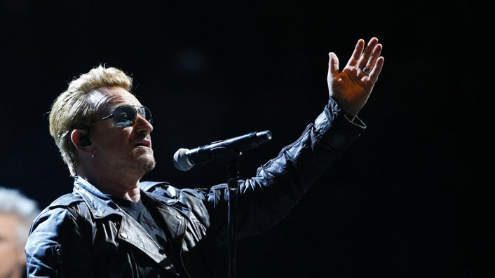 Bono pays tribute to Parisians at rescheduled U2 concert