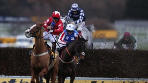 Jamie Moore riding Sire De Grugy (L) survived a stewards enquiry to win the Sandown feature