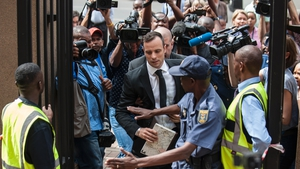Oscar Pistorius arrives for his hearing at the South African Gauteng Division High Court in Pretoria