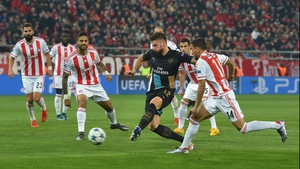 Olivier Giroud scores the second in his hat-trick against Olympiacos