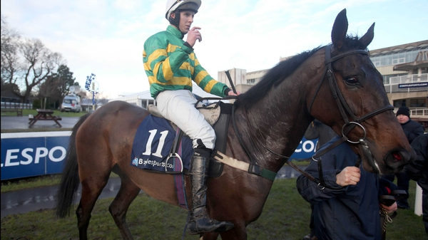 Mark Walsh and Gilgamboa after winning the Boylesports.com Hurdle at Punchestown in January 2014
