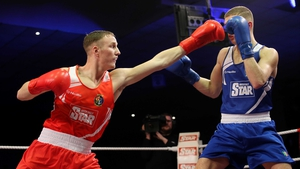 Michael O'Reilly (red) becomes the eight Irish boxer to secure Olympic qualification