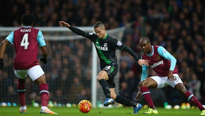 Ibrahim Afellay of Stoke competes for the ball against Alexandre Song and Angelo Ogbonna Obinz