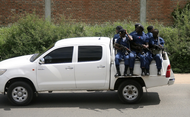 Military personnel sits aboard a vehicle driving through the Musaga neighbourhood of the city of Bujumbura