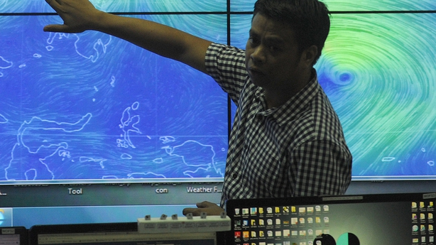 Meteorologists from the Philippine Atmospheric Geophysical and Astronomical Services Administration monitor and plot the direction of powerful Typhoon Melor