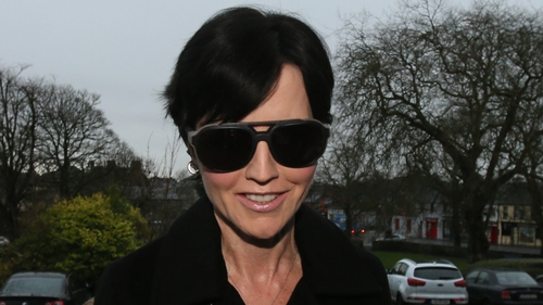 Dolores O'Riordan pleaded guilty to headbutting and spitting on a police officer