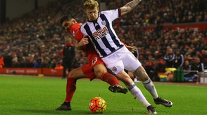 James McClean battles with Emre Can for possession at Anfield