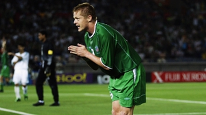 Duff celebrates by bowing to the crowd after his goal against Saudi Arabia at the 2002 World Cup