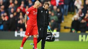 Martin Skrtel leaves the Vicarage Road pitch injured