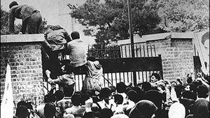 Radical Iranian students storm the US embassy in Tehran on 4 November 1979