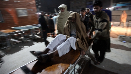 A victim of the 6.3 magnitude earthquake is brought to a hospital in Peshawar, Pakistan
