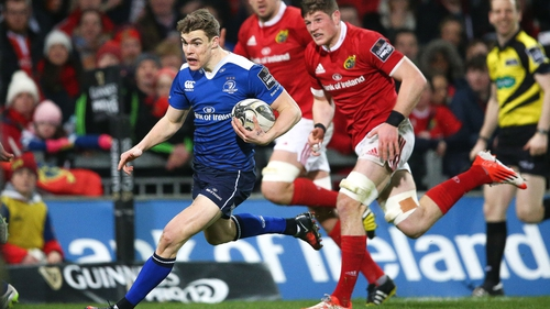 Leinster's Garry Ringrose chased by Munster's Jack O'Donoghue