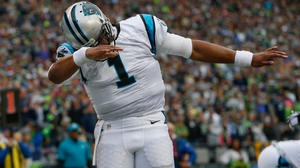 Cam Newton threw for 300 yards and two touchdowns