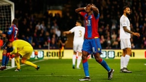 Wilfried Zaha reacts to a missed opportunity against Swansea