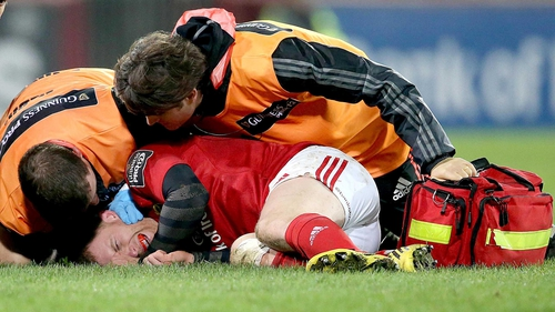 Keith Earls lies on the turf after suffering a neck injury against Leinster