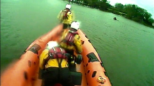 After using the lifeboat to encourage the horse to swim towards shore, the crew waded in to the water to discourage the horse from swimming back out into the lake