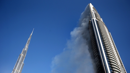Smoke continued to rise from the Address Downtown Hotel today