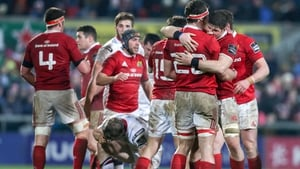 Munster players celebrate at the final whistle