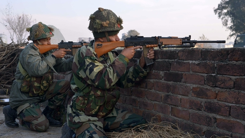 Indian army soldiers take up position on the perimeter of the base