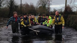 Minister Simon Coveney taking the boat in Clonlara as he visits flood-hit Clare