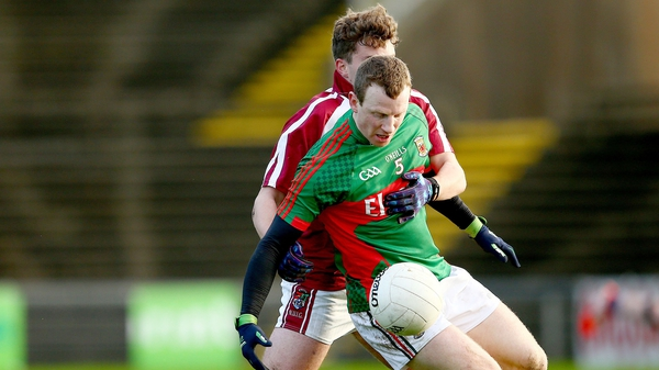 Mayo's Colm Boyle beats Kevin Finn of NUIG to the ball in Castlebar