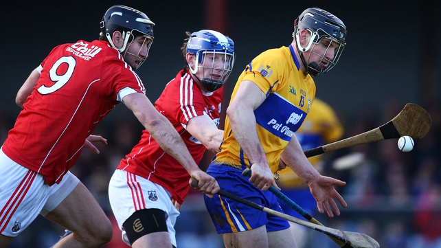 Clare's John Conlon is challeneged by Mark Ellis and Damian Cahalane of Cork