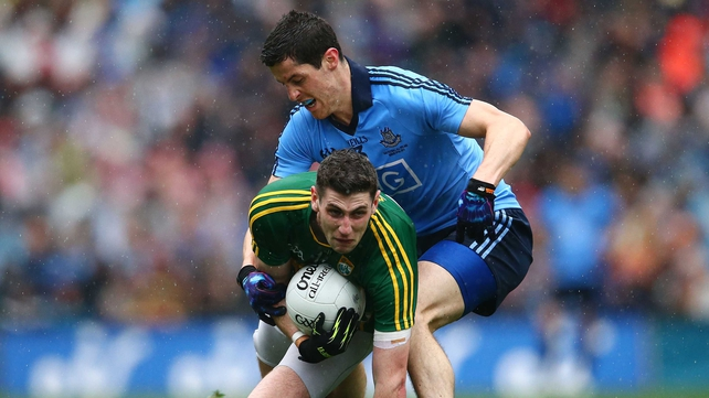 Paul Geaney of Kerry battles with Rory O'Carroll