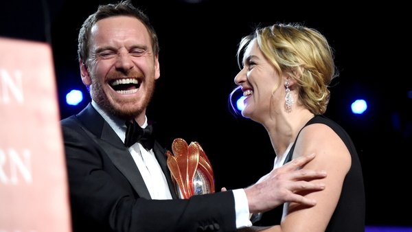 Michael Fassbender presented with the International Star Award by Kate Winslet