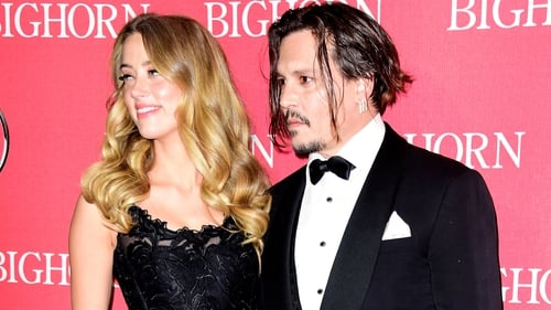 Amber Heard's lawyer denies Depp 'blackmailing' claim