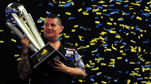 Gary Anderson with the PDC World Championship trophy
