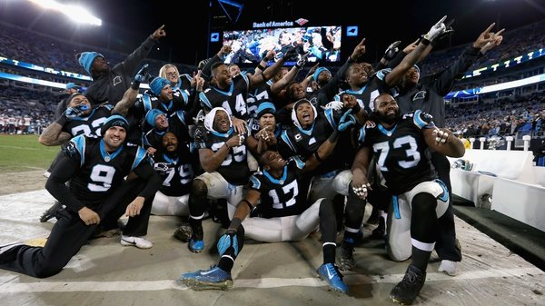 The Carolina Panthers celebrate as they grabbed top seed in the NFC