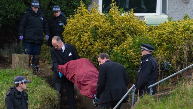 A body is removed from the house in east London