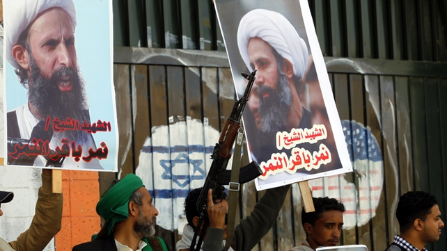 Protestors hold posters of late Shia cleric Nimr al-Nimr, who was executed in Saudi Arabia, during an anti-Saudi protest outside the Saudi embassy in Sanaa today
