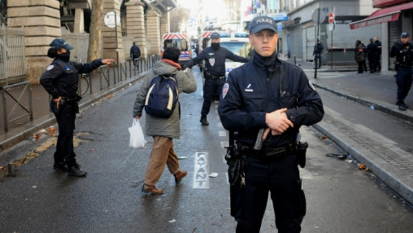 Armed French police patrol near the Boulevard de Barbes in the north of Paris