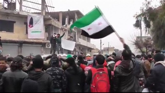 An amateur video purports to show people in the town of Saraqeb gathering in solidarity with those in Madaya