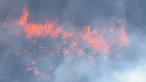 Fire fanned by strong winds doubled in size over 24hrs