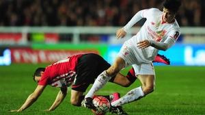 Joao Carlos Teixeira of Liverpool evades Alex Nicholls of Exeter City