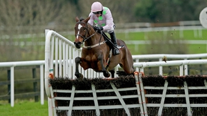 Ruby Walsh aboard Min as they clear the last at Punchestown on the way to a stylish win