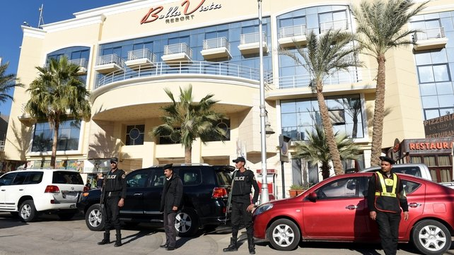 Egyptian police and security personnel stand guard in front of the Bella Vista Hotel in Egypt's Red Sea resort of Hurghada