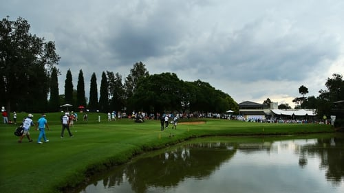 Storm clouds gather over Glendower Golf Club as players walk off after third round play was suspended