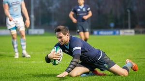 UCD's Billy Dardis scores their seventh try of their resounding won over Garryowen