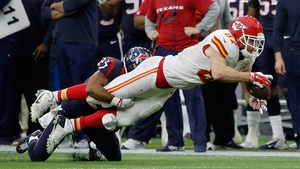 Travis Kelce of the Kansas City Chiefs is tackled by Huston Texans' Quintin Demps