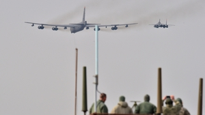 The B-52 was flanked by two fighter planes, a US F-16 and a South Korean F-15, in a low flight over Osan Air Base, south of Seoul