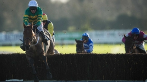Nearly Nama'd ridden by Barry Geraghty clears the last fence on his way to victory
