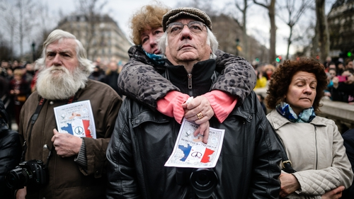 People gather to honour the victims of the terrorist attacks in 2015, at the Place de la Republique in Paris