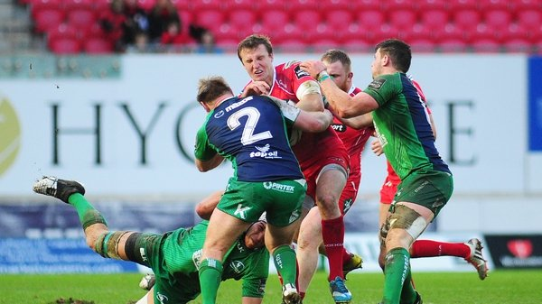 Scarlets' Hadleigh Parkes is tackled by Connacht's Ultan Dillane