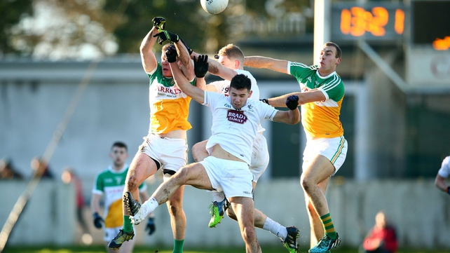 Offaly's Shane Nally and Jason Gethings soar for a high ball against Matty Byrne and Rob Kelly of Kildare